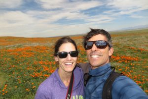 Selfie of me and Robert in front of a field of poppies.