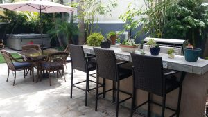 Back patio with high end bar, patio table and chairs iwht umbrella, built in fountain.