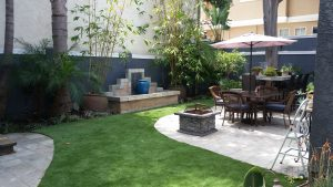 Another angle of the backyard at 2312 Huntington Lane, #2 in Redondo Beach where you can see the built in fountain and patio furniture.