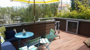 Front deck has a bistro table and chairs under an umbrella, offering another outdoor oasis in this Golden Hills single family in Redondo Beach
