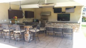 Redondo Beac home iwth outdoor patio with bar, barbecue, refrigerator, table and chairs and 3 flat screen TVs.
