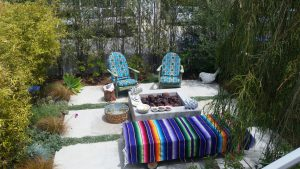 Front patio with a couple of beach chairs firepit in this private front patio at 1215 Stanford in Redondo Beach